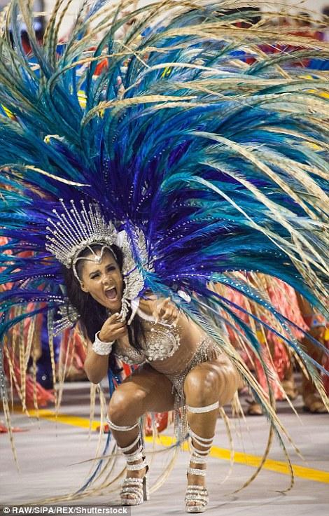 30EFE6D700000578-3434717-Revelers_of_the_Perola_Negra_and_Aguia_de_Ouro_samba_schools_per-a-44_1454796234020