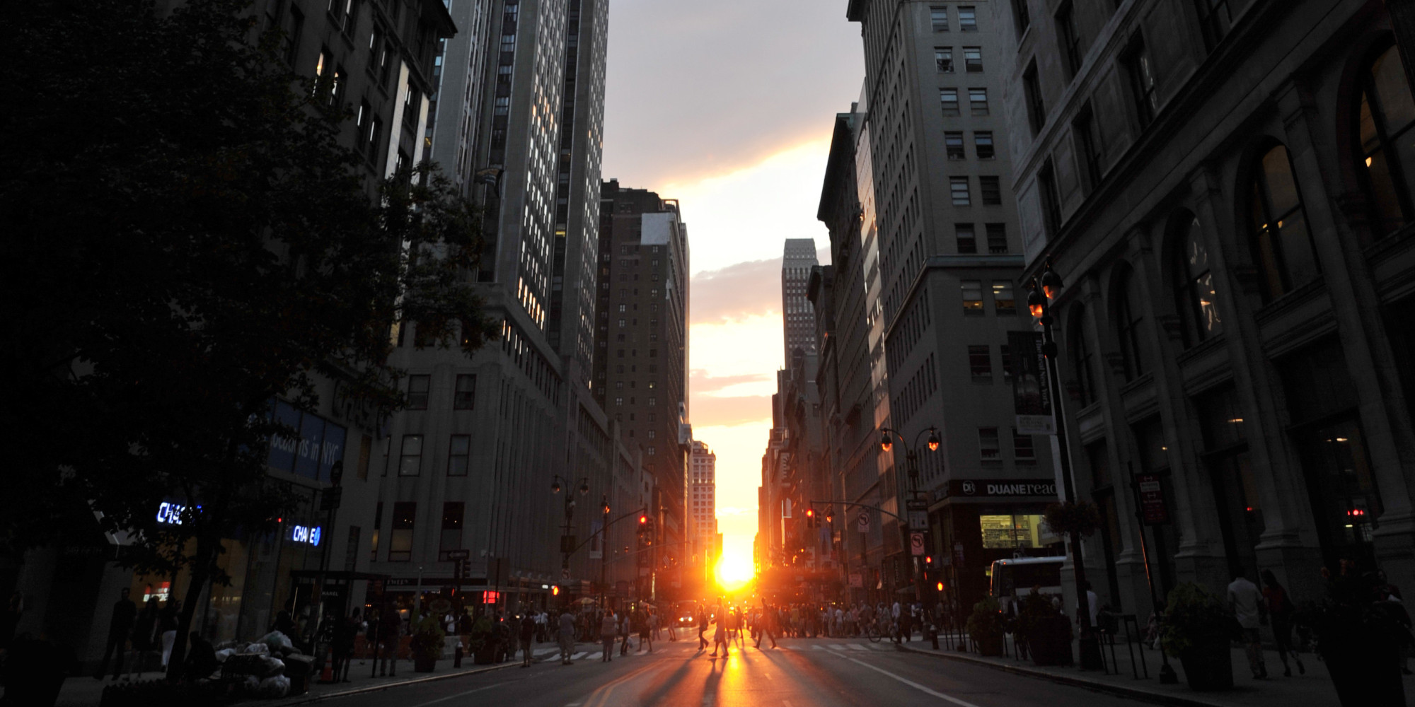 "Past the Empire State Building (L), the sun sets along 34th Street aligning with the Manhattan street grid during ""Manhattanhenge"" July 13, 2011 in New York. It is dubbed ""Manhattanhenge"" and happens two times a year when the Sun aligns at dusk with streets in a glowing magic trick as rays of sunlight span across New York perfectly, from west to east. ""Manhattanhenge may just be a unique urban phenomenon in the world,"" says astrophysicist Neil deGrasse Tyson, of the American Museum of Natural History, who officially discovered the phenomenon. The name ""Manhattanhenge"" is a play on Manhattan, this city's most famous borough, and Stonehenge, the megalithic monument in southern England with large stone blocks set out in concentric circles. At Stonehenge, the Sun crosses the site's central axis during the summer and winter solstices, leading experts to speculate that the site could have been used as a sort of sun calendar, as well as for religious ceremonies. AFP PHOTO / Stan HONDA (Photo credit should read STAN HONDA/AFP/Getty Images)"